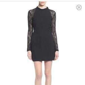 Black lace body con dress.